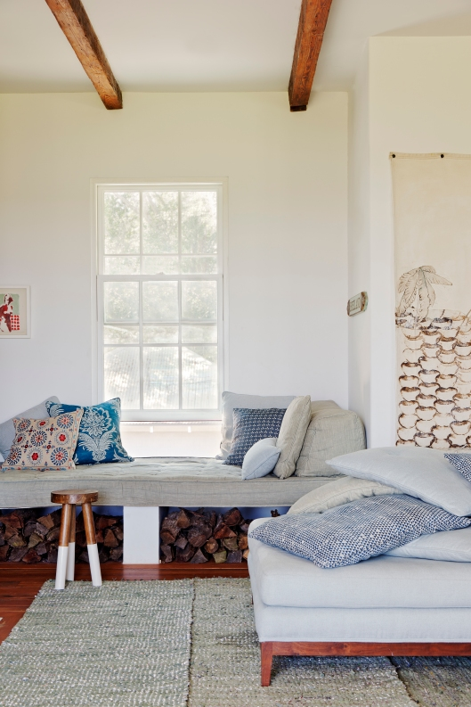 Window seat pictured in light blue green linen with pillows from Tulu and Zak + Fox. Abney & Morton Interiors and Michael Moran designed daybed with oversize pillows of various shades of blue linen and Walter G huts fabric.