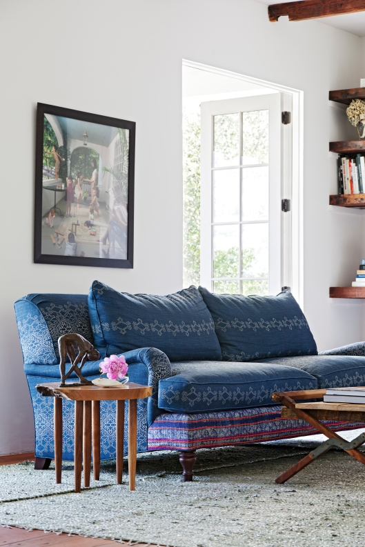 Lisa Fine Aswan in ink indigo mixed with a vintage textile upholstered sofa with a Michael Moran side table
